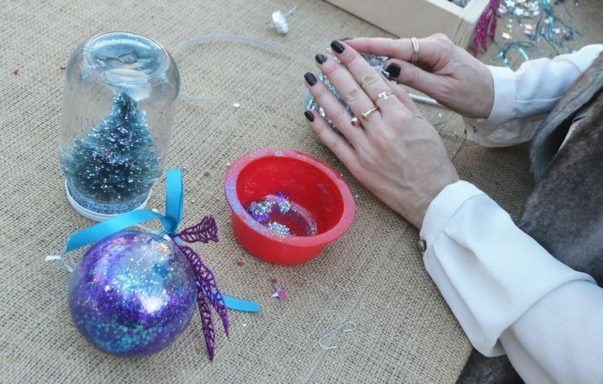 ... Or, why not glitter? Dab some glue in the ornament first, so sparkles will stick.
