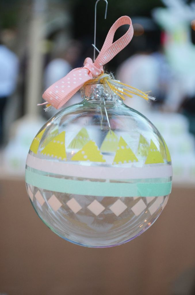 Decorative tape and stencil designs make it easy to create custom ornaments