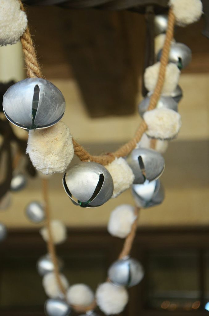 String together bells and pom-pom's for a creative garland